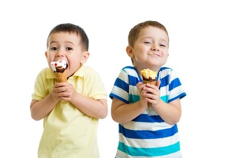 face cream: funny children kids little boys eat ice-cream isolated on white