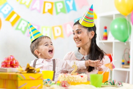 child boy and his mom have fun on birthday photo