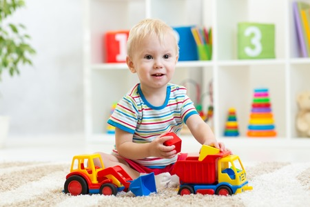 hand truck: child boy toddler playing with toy car