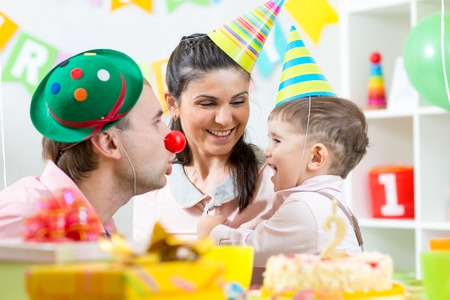 family have fun celebrating birthday of child boy photo