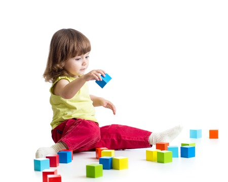 tower block: toddler kid playing  wooden toy blocks isolated Stock Photo