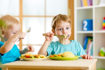 children eat healthy food in nursery or at home