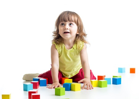 toy blocks: toddler child girl playing  wooden toy blocks isolated on white