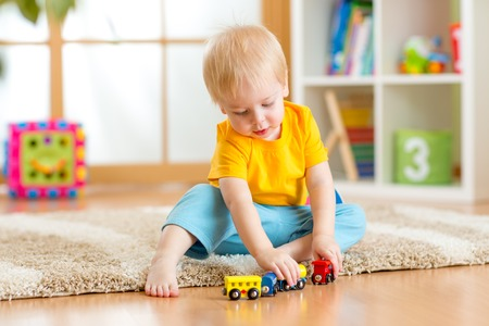 two year: kid boy playing toys at home or kindergarten