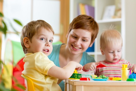 little dough: kids and mother play colorful clay toy Stock Photo