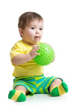 cute baby boy playing with massage ball Stock Photo