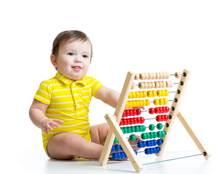 prodigy: Smiling baby kid playing with counter toy Stock Photo
