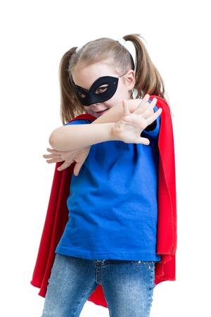 child girl plays superhero isolated on white photo