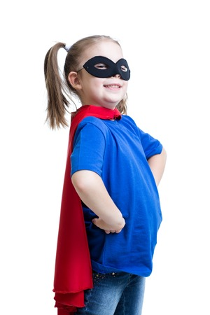 kid girl dressed as superman or superhero isolated