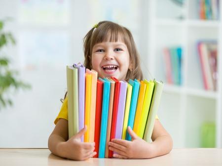 prodigy: Cute kid girl preschooler with books at home Zdjęcie Seryjne