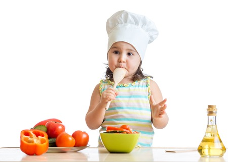 funny kid girl preparing healthy food isolated