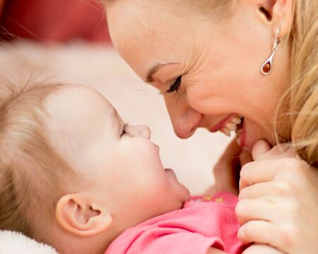 Mother looks with love at baby. Maternity happiness. photo