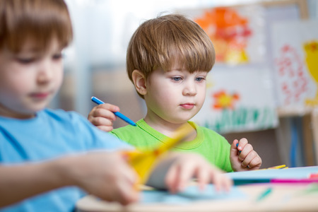 children painting: children brothers painting in nursery at home