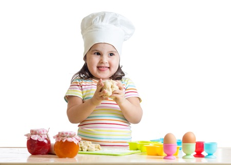 little dough: kid little girl kneading dough in kitchen