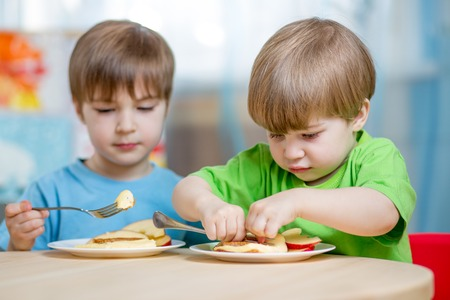 kasha: kids eating healthy food at home or kindergarten