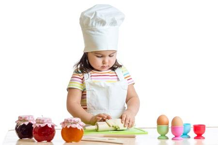 hand jam: little baker kid girl in chef hat making dough