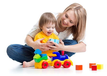 block: happy family - child boy and mom play with toys