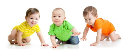 toddler: funny smiling babies toddlers crawling isolated on white Stock Photo