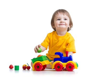 little boy toddler playing with toy isolated