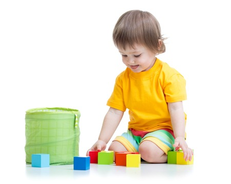 kid boy playing color wooden toys isolated photo