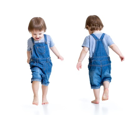 Happy kid little boy running, isolated on white. Front and rear view. Stock Photo