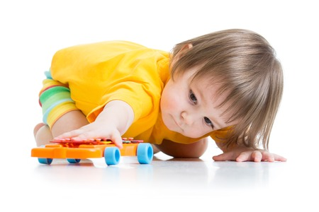 little boy toddler playing with toy car isolated Stock Photo