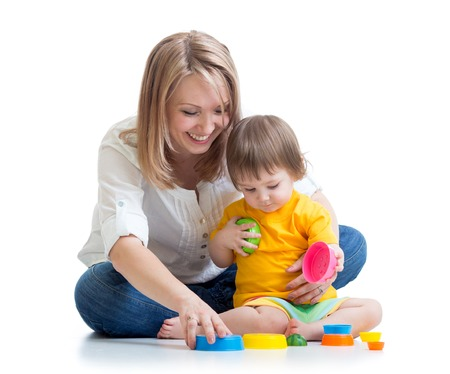 child and mother playing  with toys isolated photo
