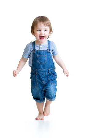 Happy child little boy running isolated over a white