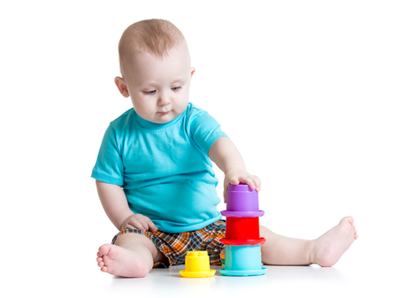 baby little boy playing with color toys photo