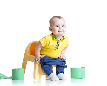 chamber pot: smiling child sitting on chamber pot with toilet paper rolls