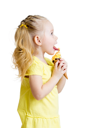 licking: kid girl eating ice-cream in studio isolated