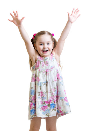 smiling child girl with hands up isolated on white background photo