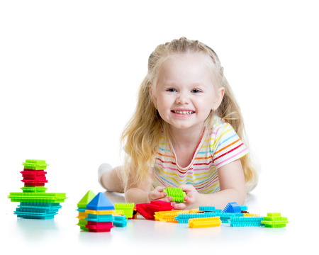 Portrait of sweet kid little girl with toy blocks photo