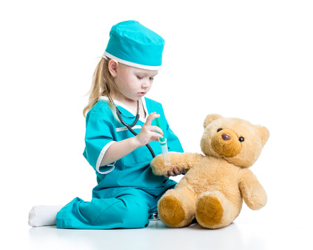 cute child girl with clothes of doctor playing toy Stok Fotoğraf
