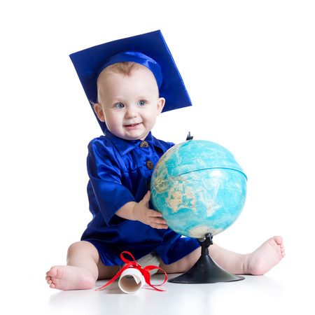 Portrait of cute baby boy in student hat with globe and scroll