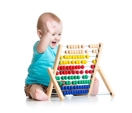 prodigy: Smiling baby boy playing with counter toy