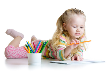 child little girl drawing with pencils in nursery