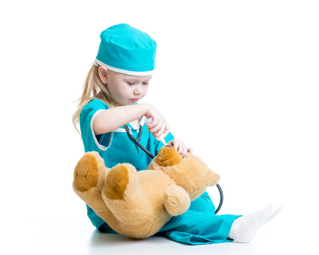 animal doctor: kid girl playing a doctor isolated on white