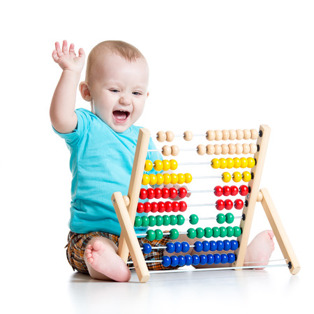 Prodigy: Happy baby boy playing with counter toy
