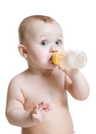 adorable baby boy drinking water from bottle Banco de Imagens