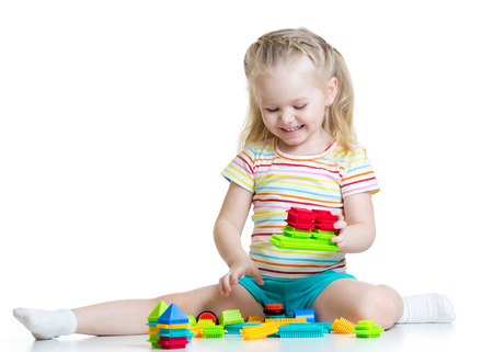 play blocks: kid little girl playing block toys isolated on white Stock Photo