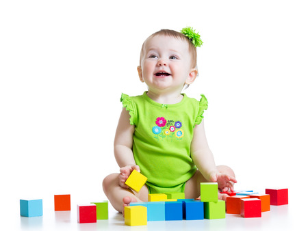 child girl playing  colorful cubes toys isolated photo