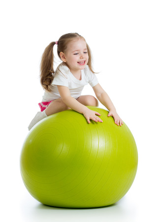 fit ball: kid girl doing fitness exercise with fitness ball