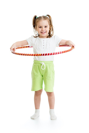 kid girl doing gymnastic with hoop on white background Foto de archivo