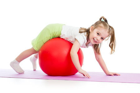 playschool: child girl doing gymnastic exercises with fitness ball