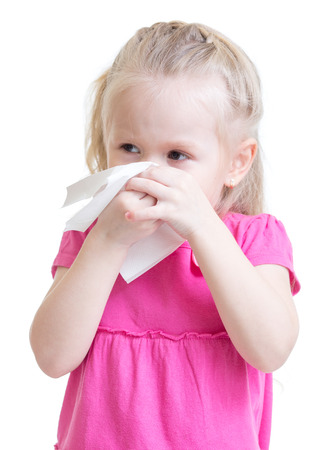 allergic reaction: sick kid wiping or cleaning nose with tissue isolated on white