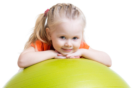 girl  care: kid girl doing fitness exercise with fitness ball