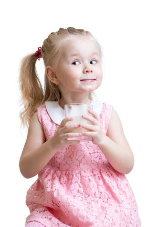 kefir: Funny kid girl with a glass of milk or yogurt isolated
