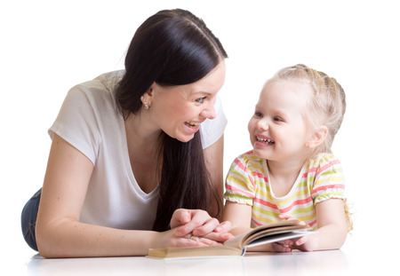mother teaches reading book to kid daughter photo