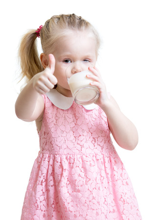 kefir: Kid drinking yoghurt from glass and showing thumb up